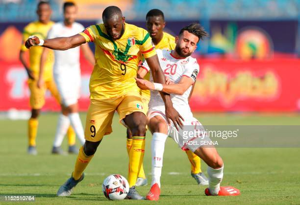 Mali's forward Moussa Marega is tackled by Tunisia's midfielder Ghaylen Chaalali during the 2019 Africa Cup of Nations Group E football match between...