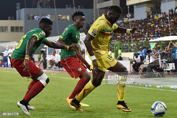 Mali's midfielder Bakary Sako challenges Cameroon's defender Ambroise Oyongo and Cameroon's forward Benjamin Moukandjo during the 2015 African Cup of...