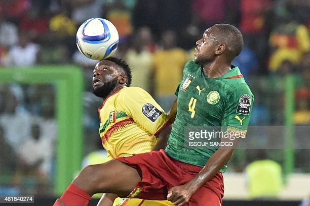 Mali's midfielder Bakary Sako heads the ball with Cameroon's midfielder Raoul Cedric Loe during the 2015 African Cup of Nations group D football...