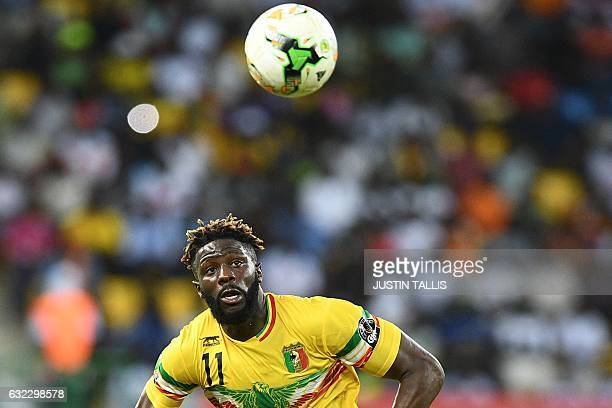 TOPSHOT Mali's midfielder Bakary Sako prepares to head the ball during the 2017 Africa Cup of Nations group D football match between Ghana and Mali...