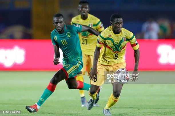 Mali's midfielder Diadie Samassekou is marked by Mauritania's midfielder El Hacen EL Id during the 2019 Africa Cup of Nations football match between...