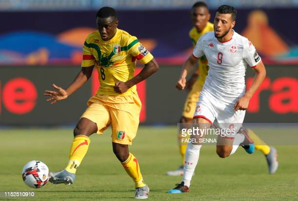 Mali's midfielder Diadie Samassekou is marked by Tunisia's forward Anice Badri during the 2019 Africa Cup of Nations Group E football match between...