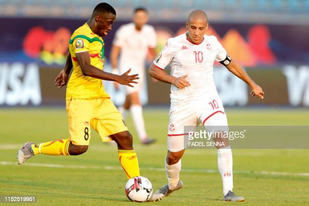 Mali's midfielder Diadie Samassekou vies for the ball with Tunisia's forward Wahbi Khazri during the 2019 Africa Cup of Nations Group E football...