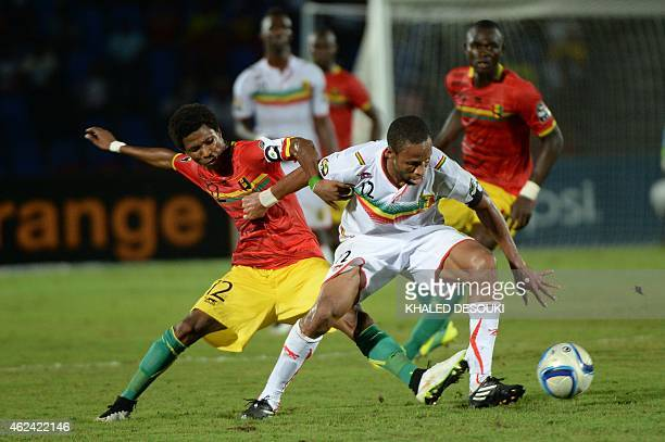 Mali's midfielder Seydou Keita vies withGuinea's midfielder Ibrahima Conte during the 2015 African Cup of Nations group D football match between...