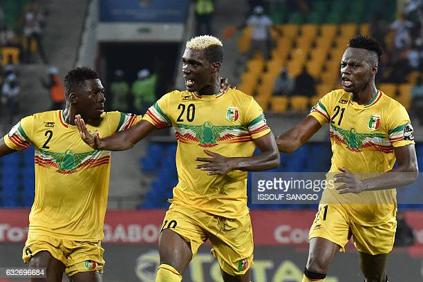 Mali's midfielder Yves Bissouma celebrates with Mali's defenders Hamari Traore and Mahamadou N'Diaye after scoring a goal during the 2017 Africa Cup...