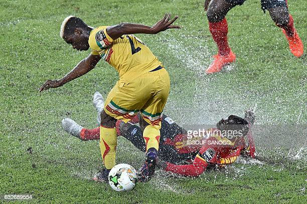 TOPSHOT Mali's midfielder Yves Bissouma challenges Uganda's defender Godfrey Walusimbi during the 2017 Africa Cup of Nations group D football match...