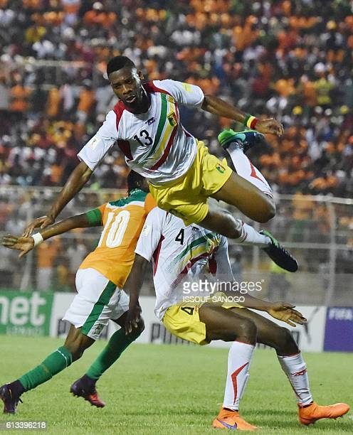 Mali's Mola Wague vies for the ball during the FIFA World Cup 2018 football qualification match between Ivory Coast and Mali at the stade de la Paix...