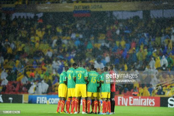 Mali's players pray before the FIFA U20 World Cup Group A first round football match against South Korea at the Nemesio Camacho stadium in Bogota...