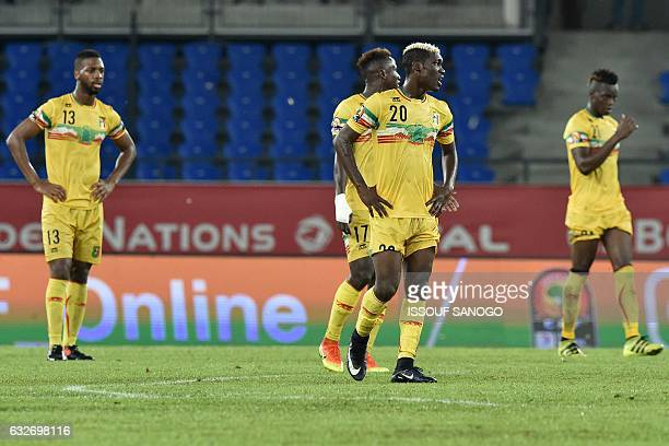 Mali's players react after conceding a goal during the 2017 Africa Cup of Nations group D football match between Uganda and Mali in Oyem on January...