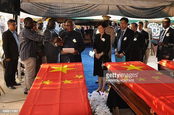 Mali's President Ibrahim Boubacar Keita attends the funeral ceremony of the three Chinese nationals who died in an attack at the Radisson Blu hotel...