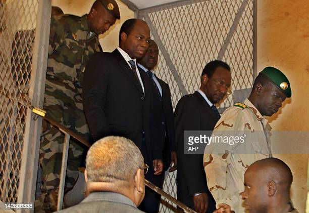 Mali's speaker of parliament Dioncounda Traore follows Captain Amadou Sanogo after they met on April 9 2012 at the Kati military barracks outside...