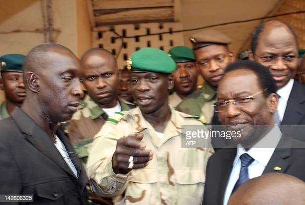 Mali's speaker of parliament Dioncounda Traore stands next to Captain Amadou Sanogo after they met on April 9 2012 at the Kati military barracks...