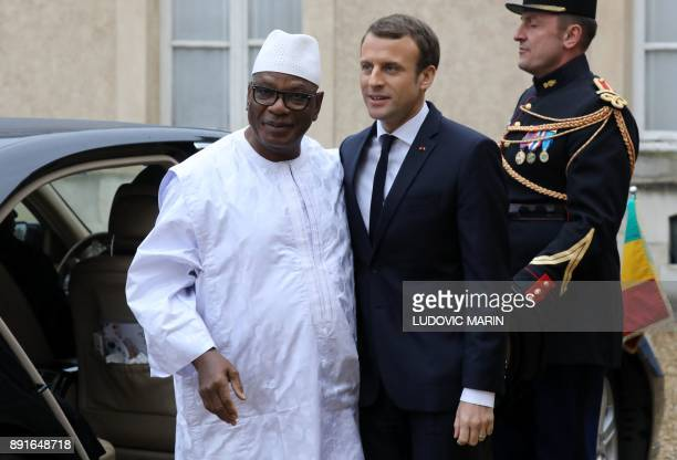 Mali's President Ibrahim Boubacar Keita is welcomed by French President Emmanuel Macron upon at his arrival for a summit from the underfunded G5...