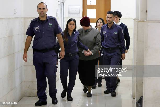 TOPSHOT Malka Leifer a former Australian teacher accused of dozens of cases of sexual abuse of girls at a school is escorted by police as she arrives...