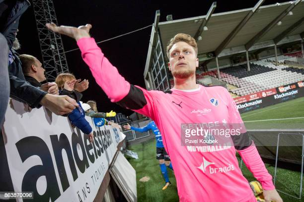 Malkolm Nilsson, goalkeeper of Halmstad BK greets the fans during the Allsvenskan match between Orebro SK and Halmstad BK at Behrn Arena on October...