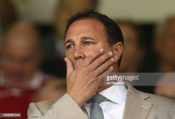 Malky Mackay looks on from the stands during the UEFA Europa League Second Qualifying Round 1st Leg match between Aberdeen and Burnley at Pittodrie...
