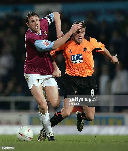 Malky Mackay of West Ham tackles Andy Gray of Sheffield United during the FA Cup Fourth round match between West Ham United and Sheffield United at...
