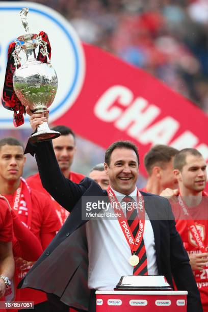 Malky Mackay the manager of Cardiff City lifts the Championship trophy after the npower Championship match between Cardiff City and Bolton Wanderers...