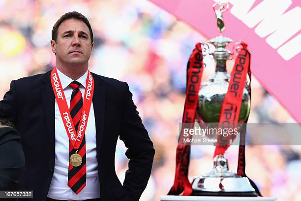 Malky Mackay the manager of Cardiff City looks towards the Championship trophy after the npower Championship match between Cardiff City and Bolton...