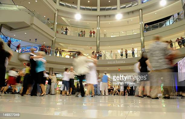 Mall goers and dancers take to the make shift dance floor during Arthur Murray Dance Centers 100th Anniversary celebration at the Mall of America on...
