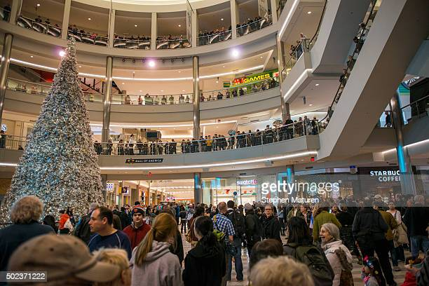 Mall goers and police queue up around the upper decks of the rotunda of the Mall of America waiting for the planned Black Lives Matter demonstration...