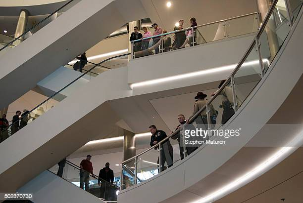 Mall goers and police queue up to around the rotunda of the Mall of America in Bloomington MN waiting for the planned Black Lives Matter...