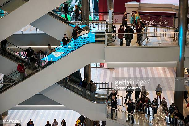 Mall goers and police queue up to around the rotunda of the Mall of America waiting for the planned Black Lives Matter demonstration on December 23...