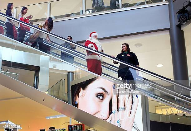 A mall Santa rides down the escalator at the North County Fair Mall on November 27 2015 in Escondido California Although Black Friday sales are...
