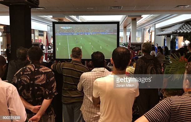 Mall Soccer fans watch a FIFA World Cup match between Brazil and Cameroon at Fareview Mall on June 23 2014 in Toronto Ontario Canada