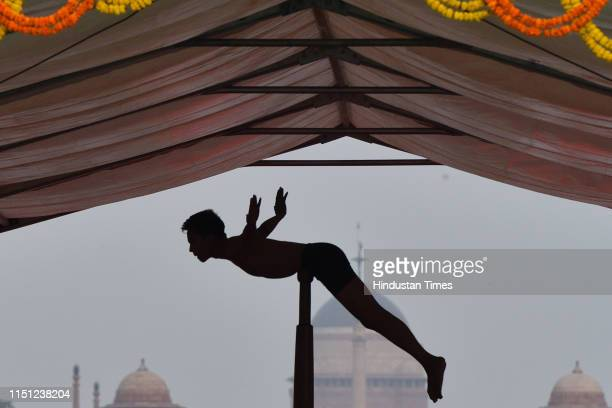 A mallakhamb practitioner participates in a mass yoga session on International Yoga Day at Rajpath on June 21 2019 in New Delhi India The...