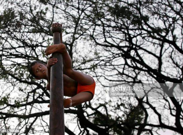 Mallakhamb Visually Challenged Blind Handicapped A blind boy gives a demonstration of Mallakhamb a yoga asana at an event oganised by the Manthan and...