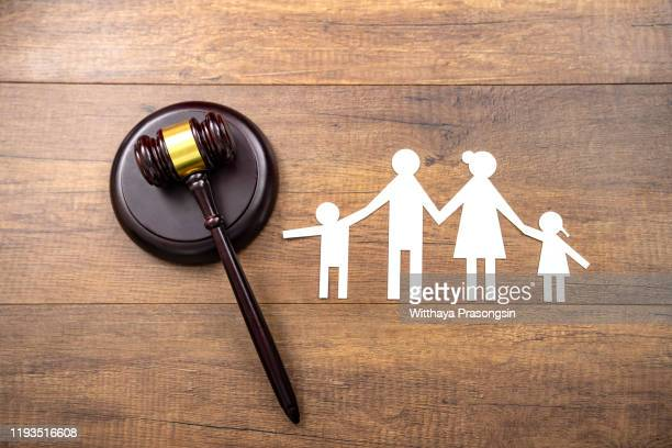 mallet showing separation of family and house - divorce kids stock pictures, royalty-free photos & images