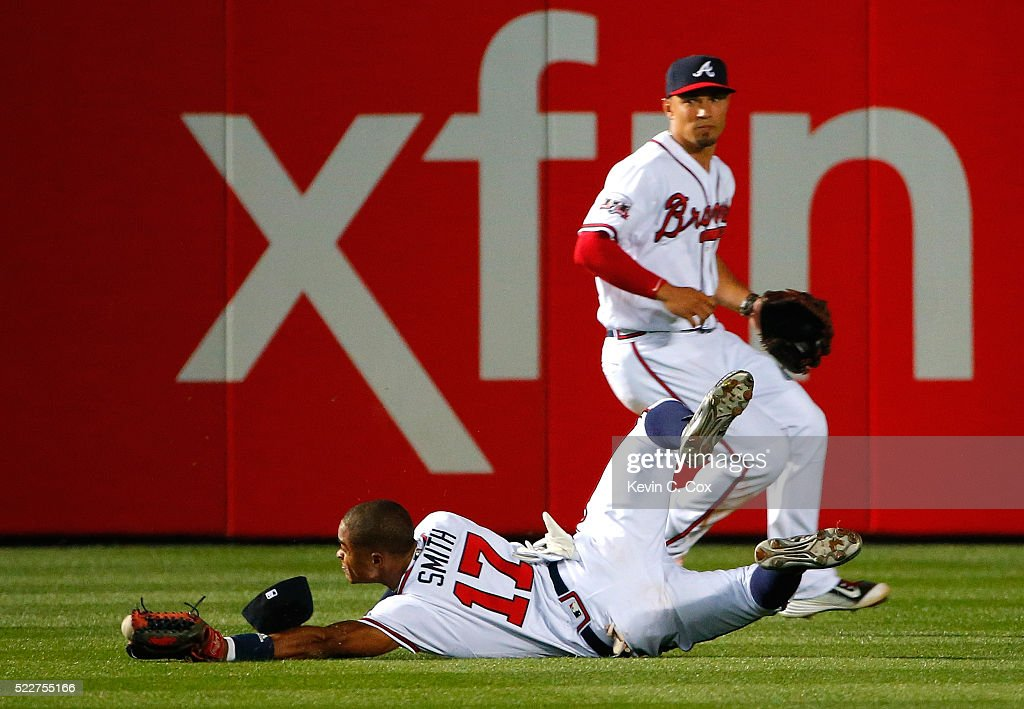 Mallex Smith #17 of the Atlanta Braves fails to catch this double hit by Justin Turner #10 of the Los Angeles Dodgers in the 10th inning at Turner Field on April 20, 2016 in Atlanta, Georgia. Chase Utley #26 scored the go-ahead run on the double.
