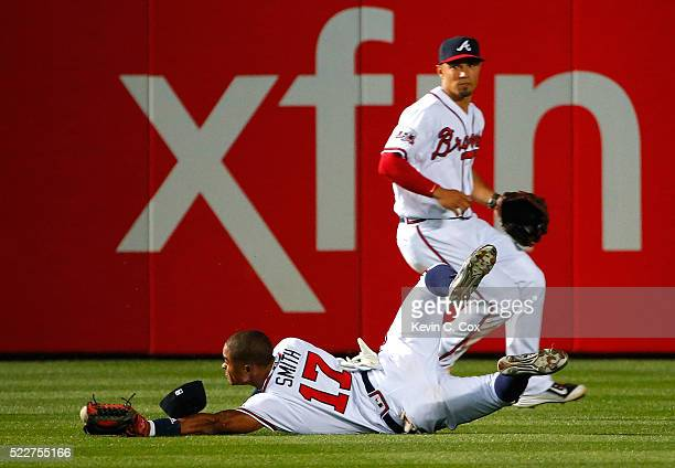 Mallex Smith of the Atlanta Braves fails to catch this double hit by Justin Turner of the Los Angeles Dodgers in the 10th inning at Turner Field on...