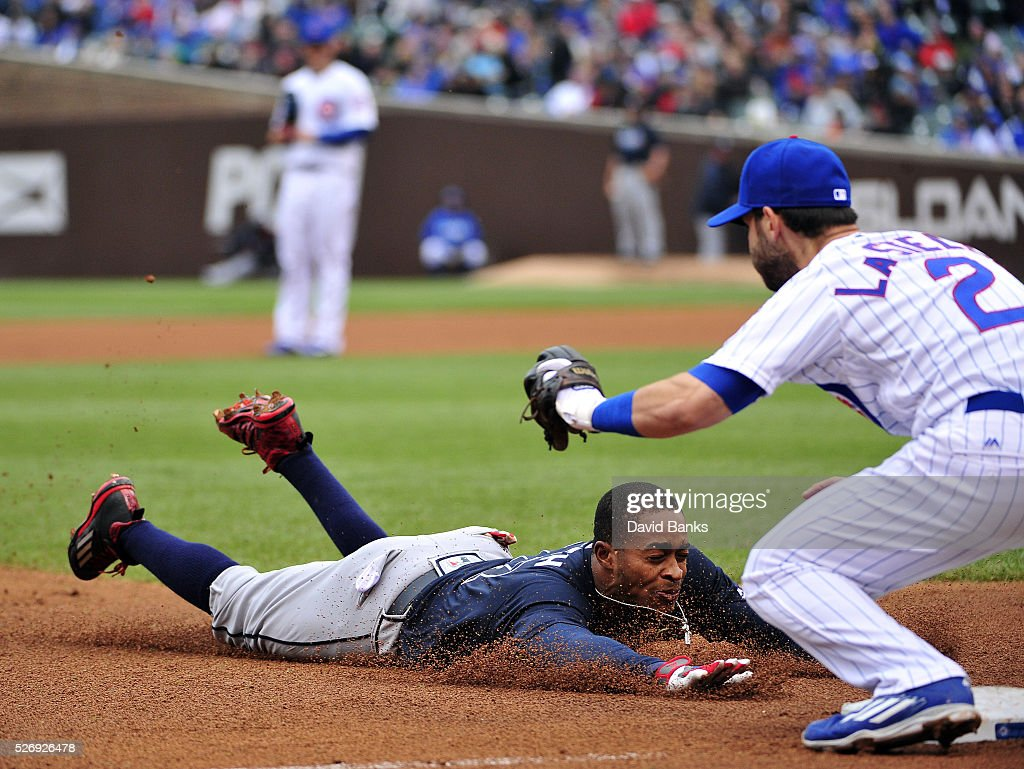 Mallex Smith #17 of the Atlanta Braves is about to be tagged out at third base as he tries for a triple by Tommy La Stella #2 of the Chicago Cubs on May 1, 2016 at Wrigley Field in Chicago, Illinois.