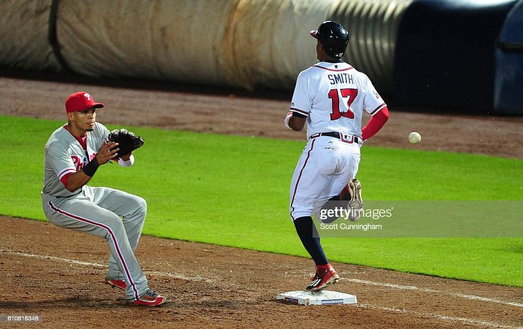 Mallex Smith #17 of the Atlanta Braves leads off the seventh inning with a bunt single against Cesar Hernandez #16 of the Philadelphia Phillies at Turner Field on September 27, 2016 in Atlanta, Georgia.