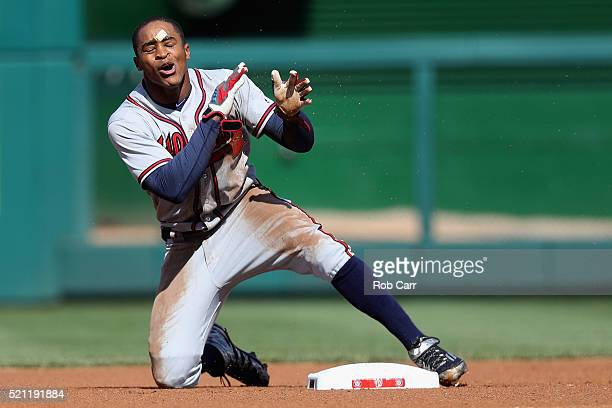 Mallex Smith of the Atlanta Braves reacts after being called out trying to steal second base against the Washington Nationals in the first inning at...