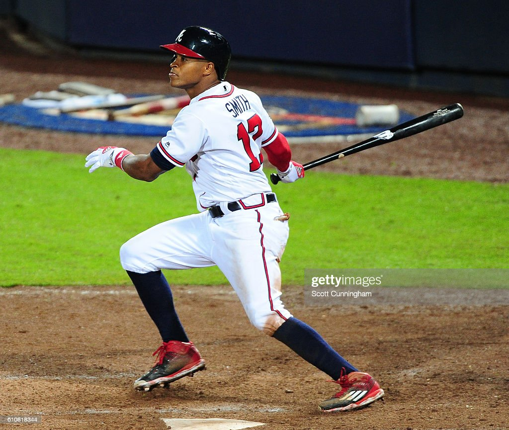 Mallex Smith #17 of the Atlanta Braves singles to knock in an eighth inning run against the Philadelphia Phillies at Turner Field on September 27, 2016 in Atlanta, Georgia.