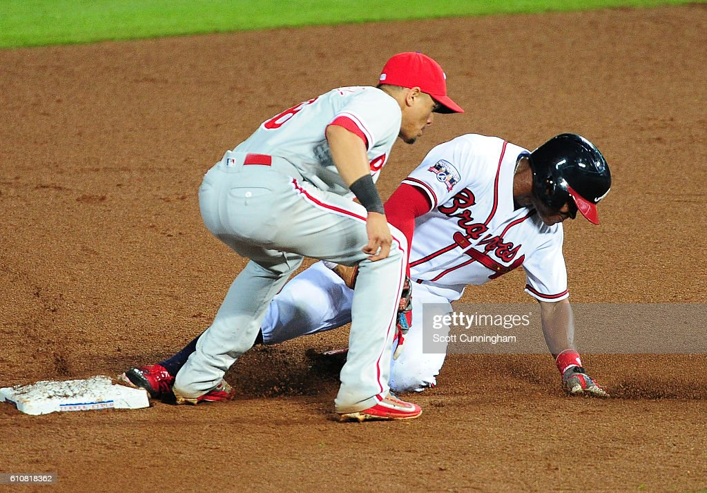 Mallex Smith #17 of the Atlanta Braves steals second base against Cesar Hernandez #16 of the Philadelphia Phillies in the seventh inning at Turner Field on September 27, 2016 in Atlanta, Georgia.