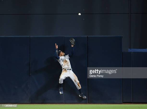 Mallex Smith of the Seattle Mariners can't make the catch on a ball that went for a tworun home off the bat of Austin Hedges of the San Diego Padres...