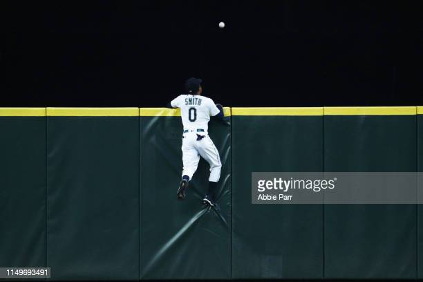 Mallex Smith of the Seattle Mariners leaps for what would be a threerun home run by Byron Buxton of the Minnesota Twins in the fourth inning at...