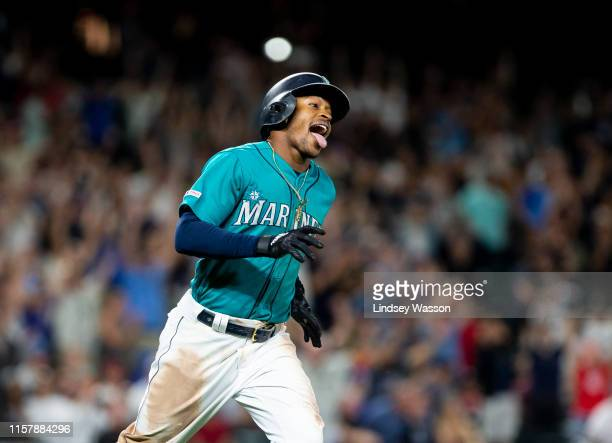 Mallex Smith of the Seattle Mariners sticks out his tongue as he runs after hitting a walkoff hit to beat the Detroit Tigers in the ninth inning at...