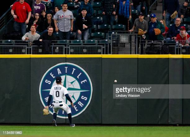Mallex Smith of the Seattle Mariners watches the ground rule double by Jonathan Lucroy of the Los Angeles Angels of Anaheim in the second inning at...