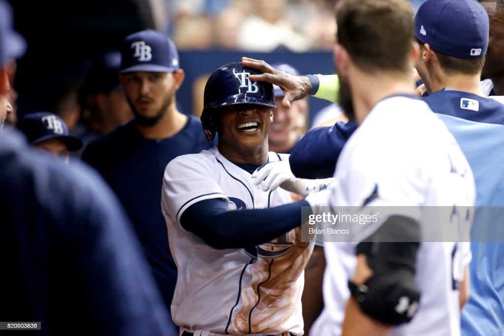 Mallex Smith #0 of the Tampa Bay Rays celebrates with teammates in the dugout after hitting a home run off of pitcher Yu Darvish of the Texas Rangers during the eighth inning of a game on July 21, 2017 at Tropicana Field in St. Petersburg, Florida.