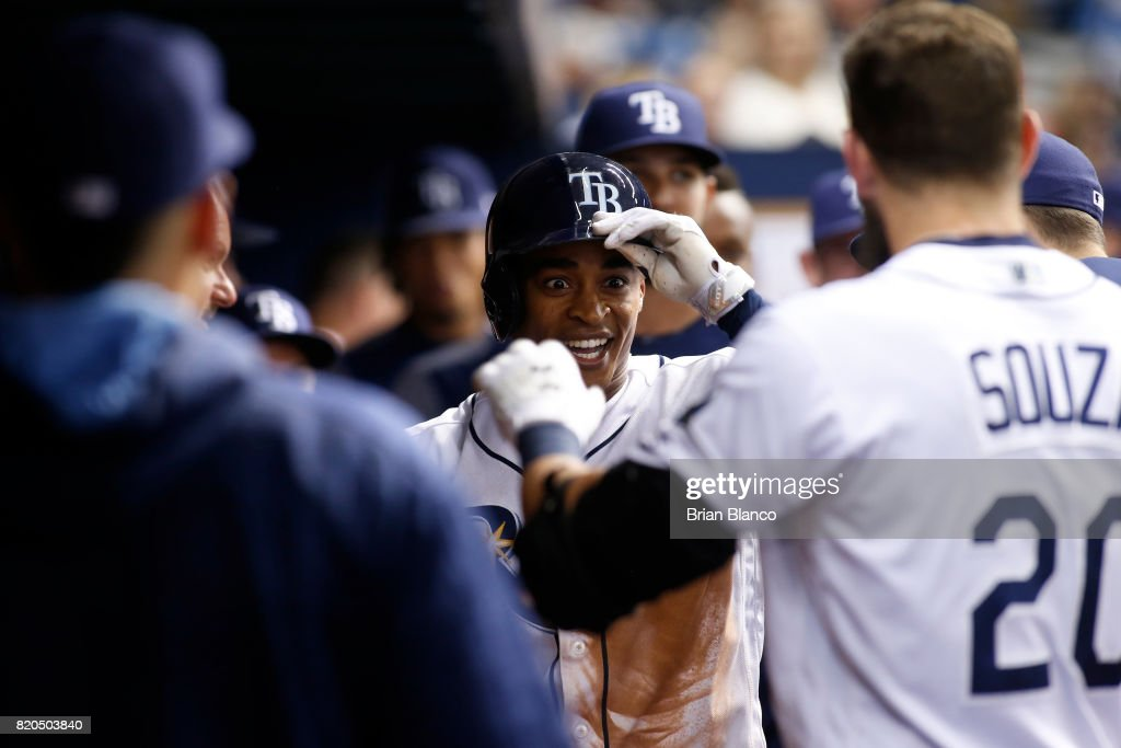 Mallex Smith #0 of the Tampa Bay Rays celebrates with teammates, including Steven Souza Jr. #20, in the dugout after hitting a home run off of pitcher Yu Darvish of the Texas Rangers during the eighth inning of a game on July 21, 2017 at Tropicana Field in St. Petersburg, Florida.