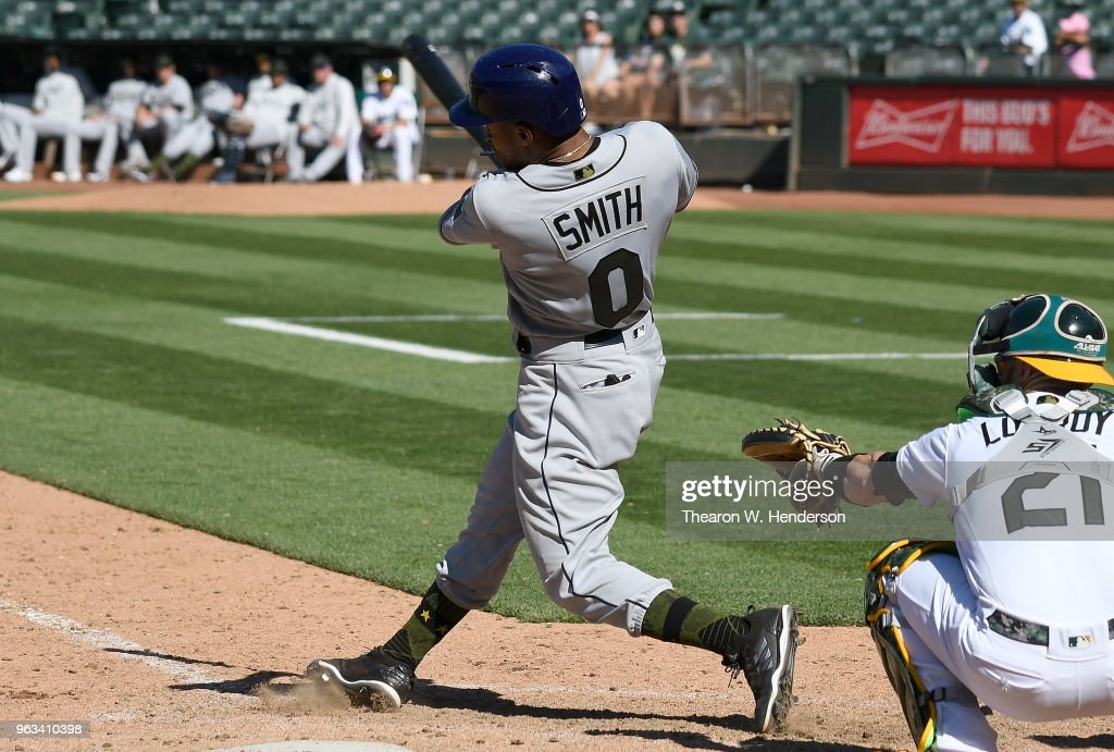 Mallex Smith #0 of the Tampa Bay Rays hits an rbi single scoring Johnny Field #10 against the Oakland Athletics in the top of the 13th inning at the Oakland Alameda Coliseum on May 28, 2018 in Oakland, California. The Rays won the game 1-0.