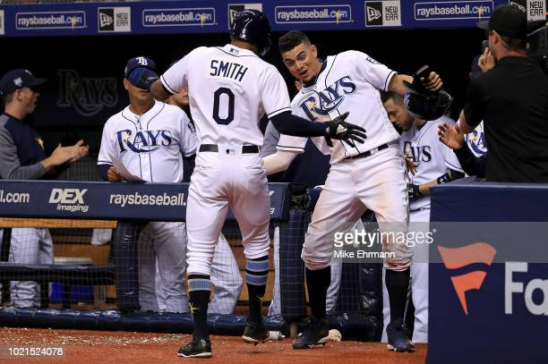 Mallex Smith of the Tampa Bay Rays is congratulated after scoring a run in the eighth inning by Willy Adames during a game against the Kansas City...
