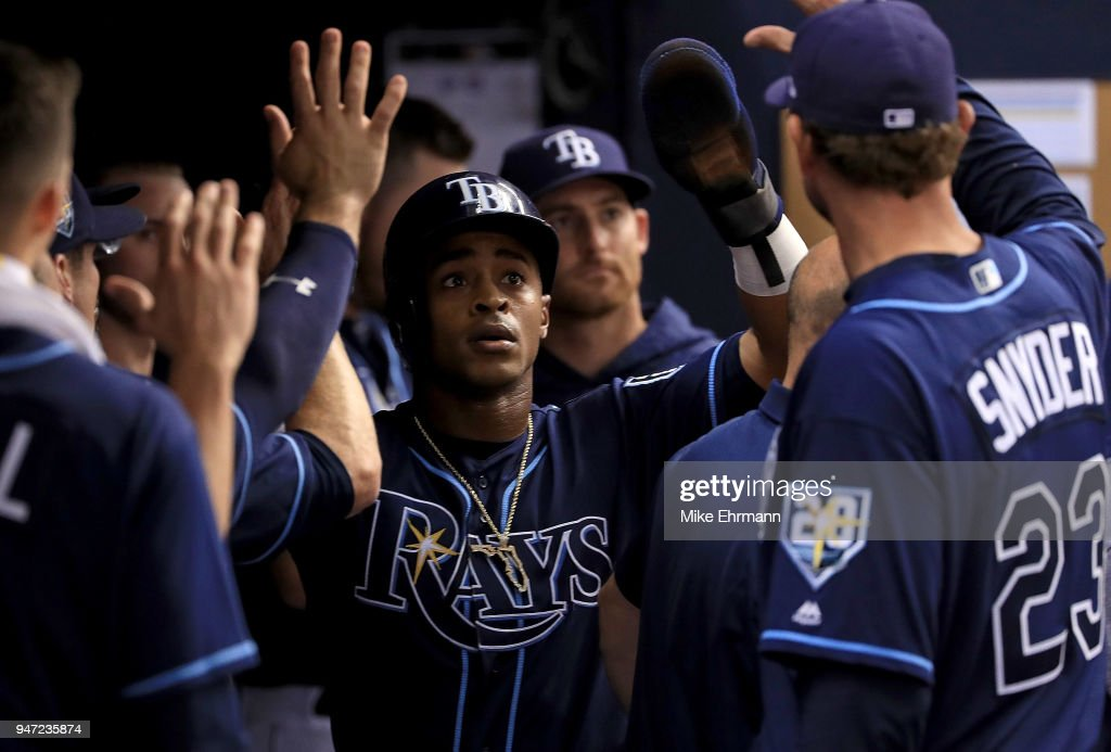 Mallex Smith #0 of the Tampa Bay Rays is congratulated after scoring a run in the second inning during a game against the Texas Rangers at Tropicana Field on April 16, 2018 in St Petersburg, Florida.