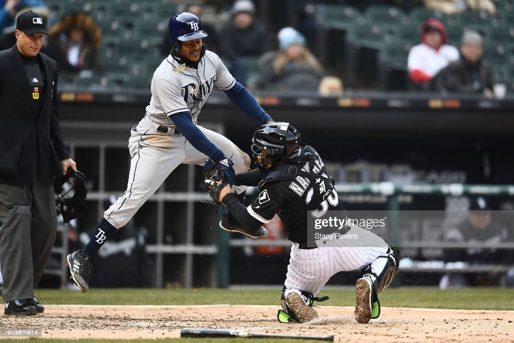 Mallex Smith #0 of the Tampa Bay Rays is tagged out at home plate by Omar Narvaez #38 of the Chicago White Sox during the fourth inning of a game at Guaranteed Rate Field on April 9, 2018 in Chicago, Illinois.