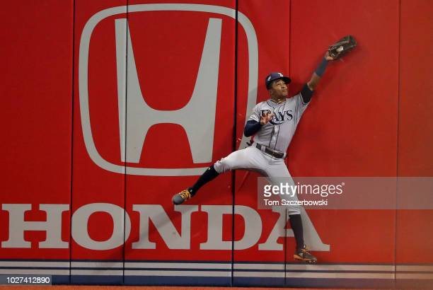 Mallex Smith of the Tampa Bay Rays makes a catch against the wall in the fifth inning during MLB game action against the Toronto Blue Jays at Rogers...